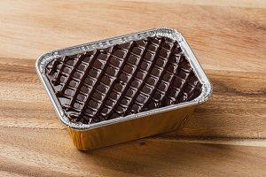 Chocolate cake in aluminium foil tra