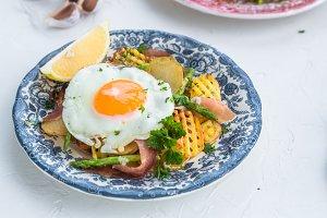 Fried egg with potato and jamon ham