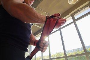 Muscular man bodybuilder putting on