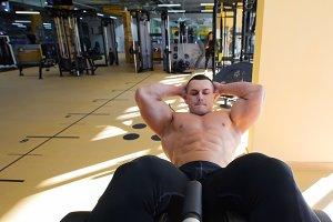 Bodybuilder with bare torso performs