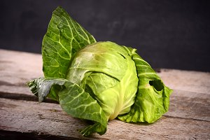 Fresh green garden cabbage on rustic