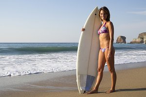 Surfer girl posing