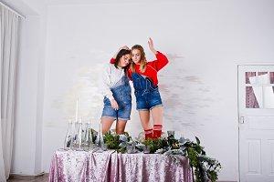 Two fun beautiful girls friends wear