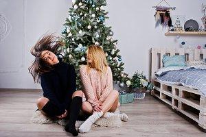 Two beautiful girls friends wear in