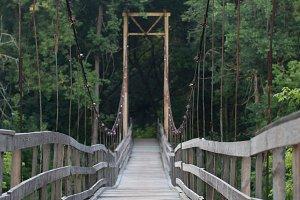 Suspension wooden bridge in the