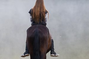 Young woman on horse about to go