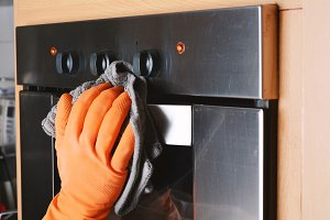 Housekeeping cleaning oven at home k