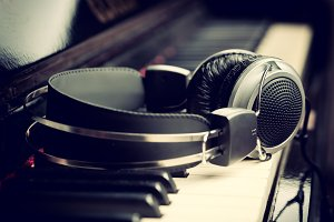 Headphones on piano keyboard