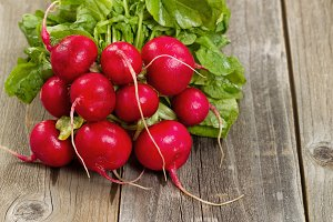 Fresh bunch of radish on aged wood