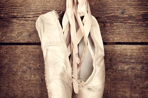 Used ballet shoes hanging