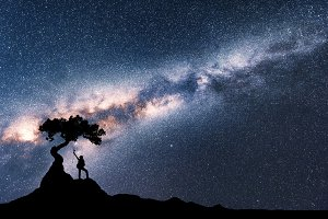 Milky Way and silhouette of woman