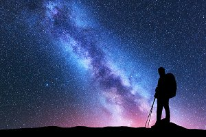 Man with backpack and Milky Way