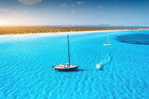 Aerial view of floating sailboat