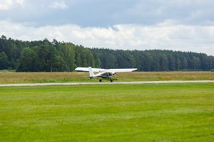 outdoor shot of small plane taking