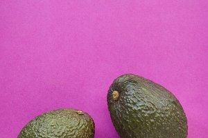 Avocado on purple minimal background