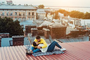 Loving young couple is sitting on th