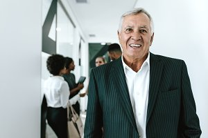 Happy senior businessman in office