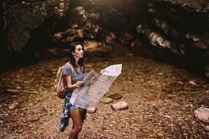 Female hiker with navigation map