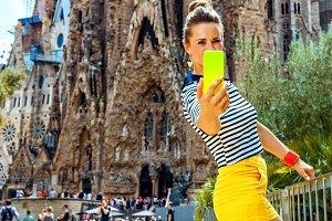 30n young tourist woman taking selfi