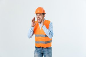 A construction worker yelling up at