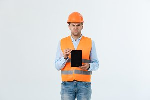 Serious Engineer man holding tablet
