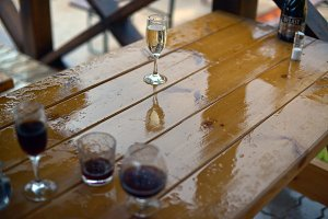 Glass of water on table in rain