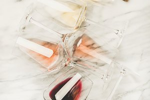 Red, rose and white wine in glasses