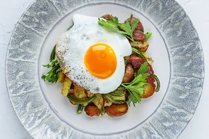Fried potato topped with sunny side