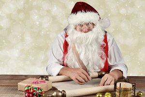 Santa Claus writing in his Naughty a