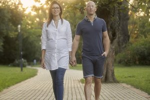 young couple walking in park trail.