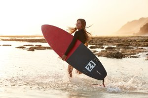 Beautiful surf girl has active lifes