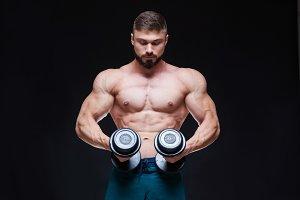 Muscular bodybuilder guy doing
