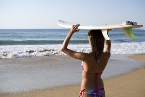 Surf girl viewing the sea
