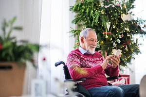 A senior man in wheelchair with