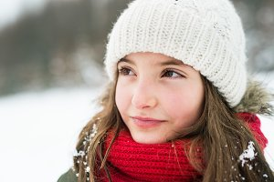 Portrait of a small girl in winter