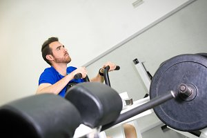 man practicing exercise in the gym