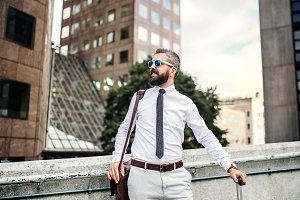 Hipster businessman with sunglasses