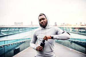 A young sporty black man runner with