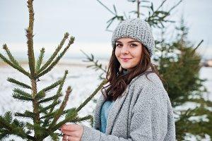 Portrait of gentle girl in gray coat