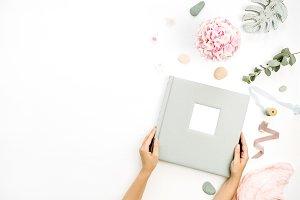 Photo album in female hands