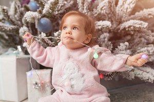 Small girl in the pink pajama sittin