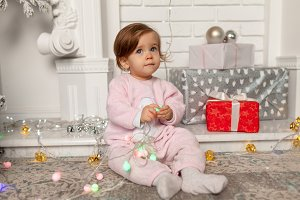 Beautiful cute little girl sitting o