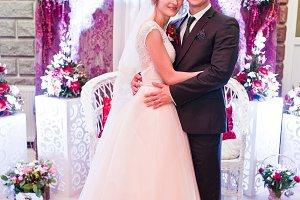 Amazing wedding couple posing under