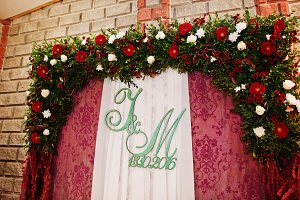 Floral wedding arch with couple's in