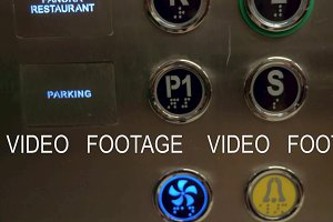 A closeup of hotel elevator buttons