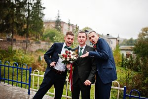 Handsome groom and his fellow grooms