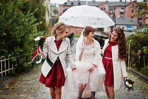 Amazing young bride and two bridesma