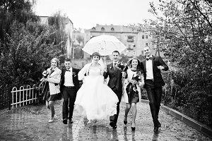 Wedding couple and groomsmen with br