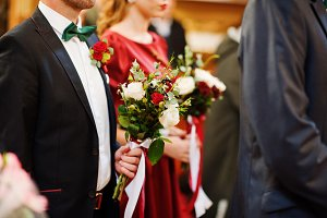 Close-up photo of groomsman and brid