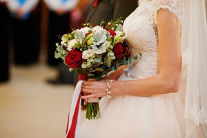 Close-up photo of a bride holding a